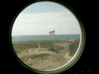 Porthole shaped window The flag is up meaning someone is there.