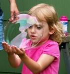 My niece peering through a bubble