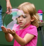 My niece peering through a bubble