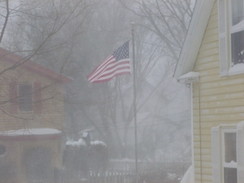 neighbors flag blowing in the wind