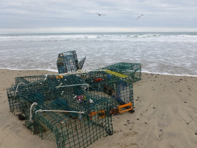 A bundle of lobster traps washed up in a winter storm.