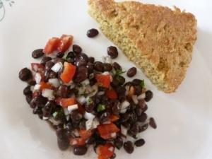 enjoying corn bread and black bean salad