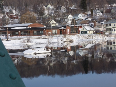 Elementary School reflected in water with the Scandinavian Village behind.  You can see the homes nestled on the hillside.