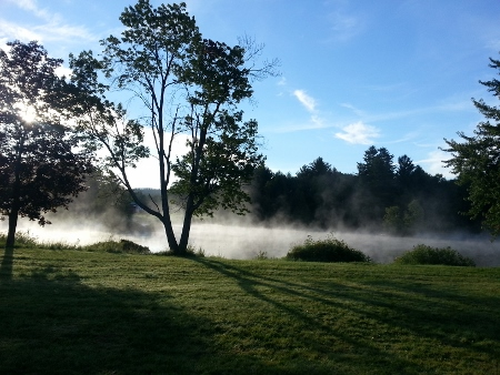 foreshadowing a beautiful day as morning mist lifts off the river