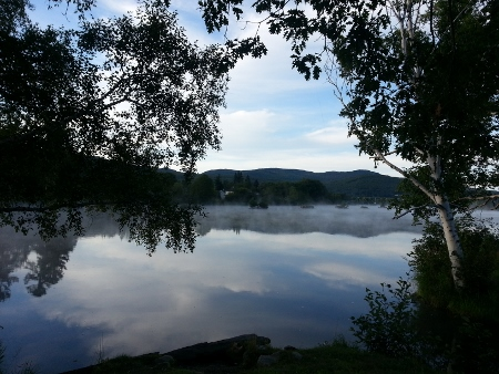 morning mist mixes with cloud reflections