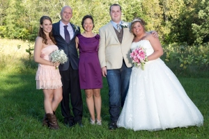 "Our family at our son's wedding.  Daughter ""O"", husband ""M"", Me, son ""M"", and daughter-in-law, ""E"""